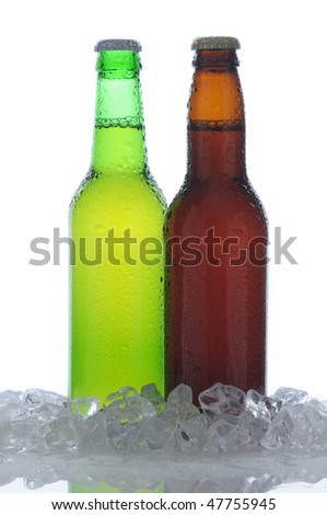 Two Backlit Beer Bottles Green and Brown Standing in Ice with Condensation and Reflection in foreground, isolated vertical composition - stock photo