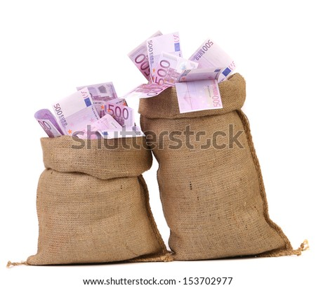 Two bags with many euro banknotes - stock photo