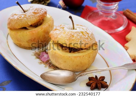 Two baked apples as Christmas dessert, hotizontal - stock photo