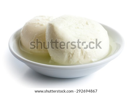 Two balls of mozzarella cheese in a dish, isolated on white. - stock photo
