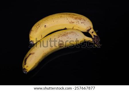 Two bananas isolated on black background  - stock photo