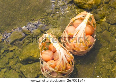 Two basket of boiled eggs in hot spring at Jaeson National Park in Lampang, Thailand - stock photo