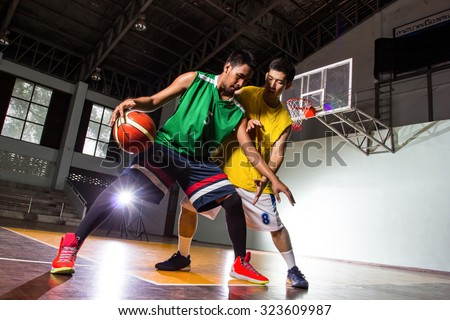 Two Basketball players competition game sport in stadium. - stock photo