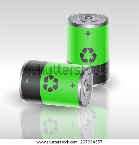 two batteries charged with renewable energy - stock photo