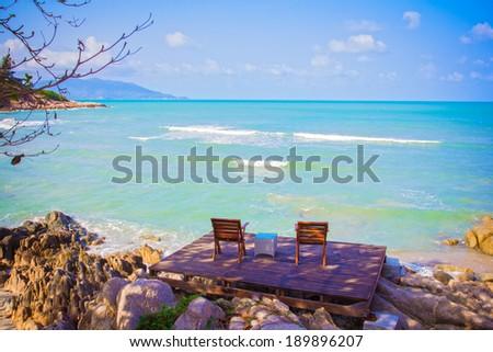 Two beach-chair beside the nice beach - stock photo