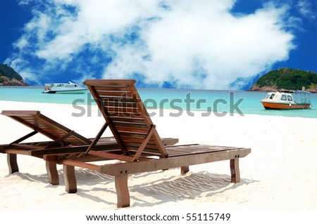 Two beach chairs on perfect tropical white sand - stock photo