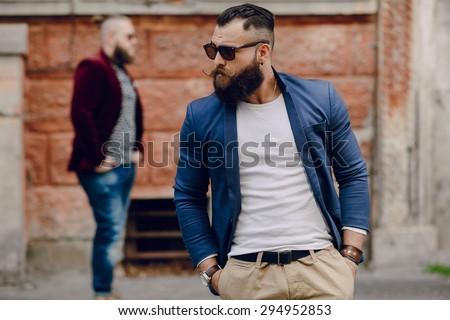 Two bearded men fashion outdoors - stock photo