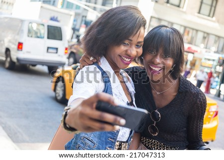 Two Beautiful Black Woman taking Selfie in New York - stock photo