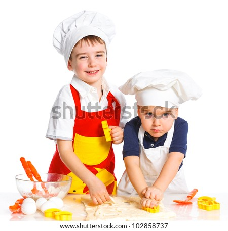Two beautiful caucasian brothers making a cake, smiling happily, isolated on white background - stock photo