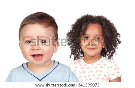 Two beautiful children looking at camera isolated on a white background - stock photo