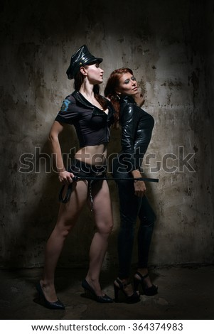 Two beautiful girls  lesbian in role suits - stock photo