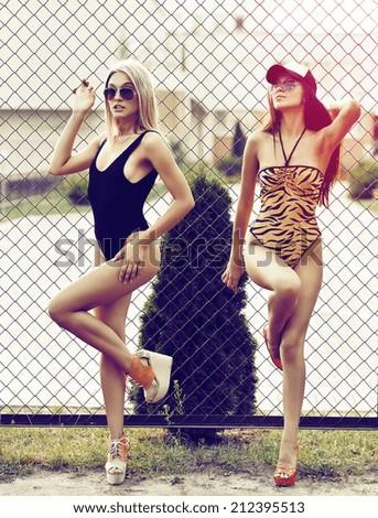 Two beautiful girls posing outdoor - stock photo