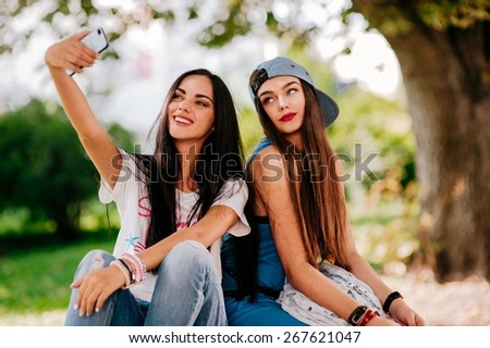 two beautiful girls rest on the street - stock photo