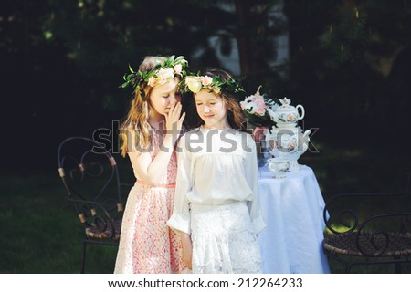 Two beautiful little bridesmaids with flowers outdoor - stock photo