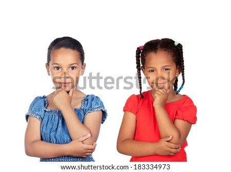 Two beautiful little girls thinking isolated on a white background - stock photo