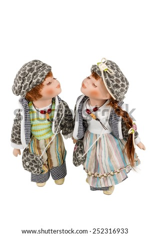 Two beautiful love doll with eyes closed standing near isolated on white background - stock photo