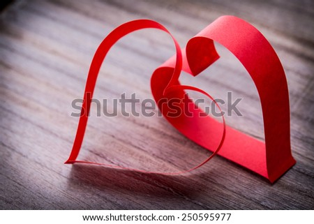 two beautiful romantic paper tape in the shape of heart on a vintage wooden background - pictures concept theme Love and St. Valentine's Day - stock photo