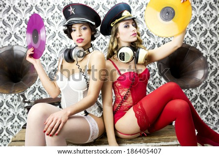 two beautiful sexy disco women in lingerie with vintage gramophones - stock photo