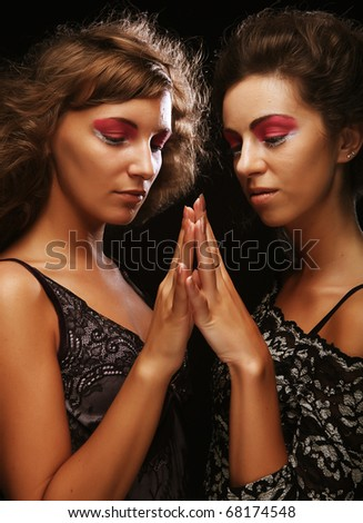 two beautiful slim sexy young girls with bright  make-up - stock photo
