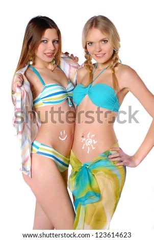 Two beautiful smiling girl in bikini - stock photo