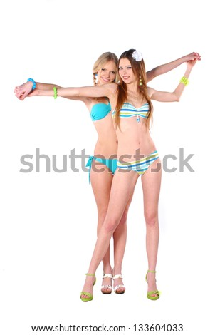 Two beautiful smiling girl in bikini - stock photo