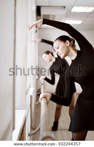 two beautiful woman in ballet class - stock photo