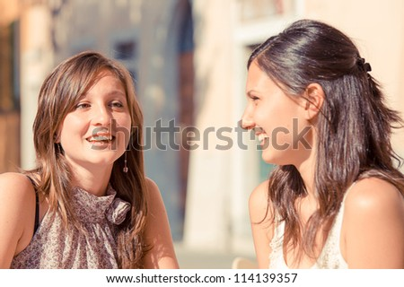 Two Beautiful woman in the city, Italy - stock photo