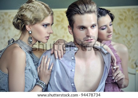 Two beautiful women and an handsome guy - stock photo