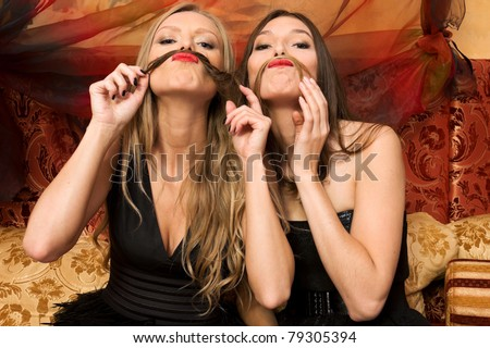 Two beautiful women are having fun - stock photo