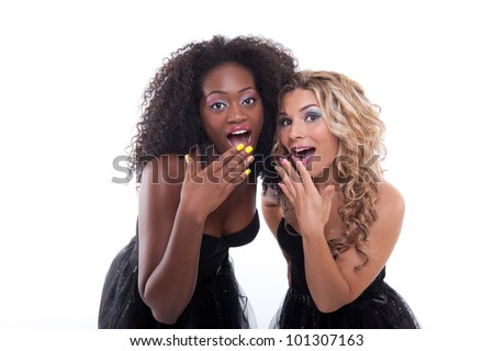 two beautiful women in black dresses looking amazed - stock photo