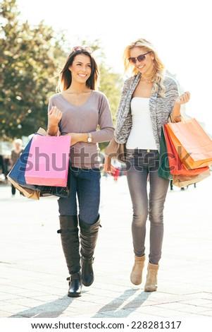 Two beautiful women in shopping - stock photo