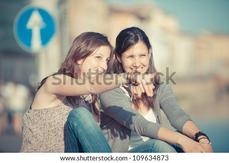 Two Beautiful Women in the City - stock photo