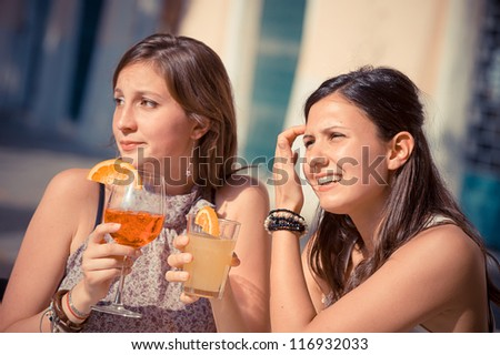 Two Beautiful Women in the City, Italy - stock photo