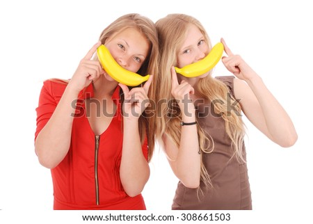 Two beautiful young caucasian girl with banana smile isolated on white - stock photo