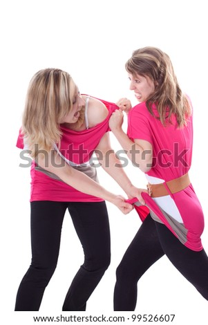 two beautiful young woman are fighting because of a dress - stock photo