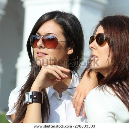 Two Beautiful young women in sunglasses - stock photo