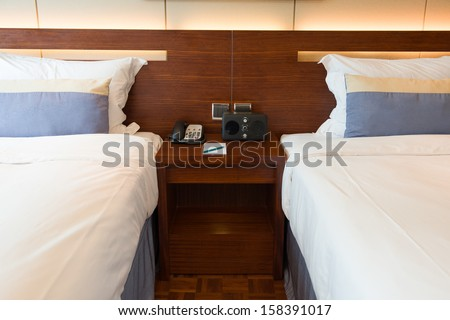 two beds in a hotel room - stock photo