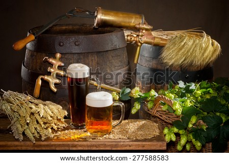 two beers with raw material for beer production - stock photo