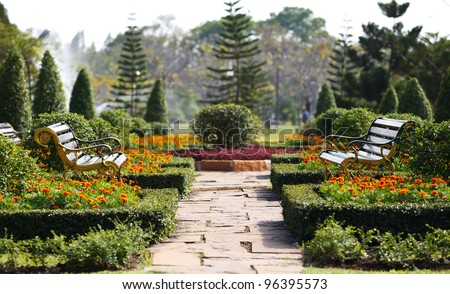 Two benches in the garden near Bangkok Thailand. - stock photo