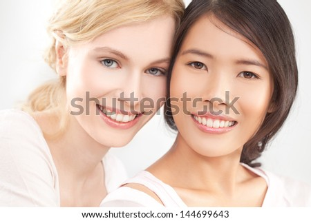 Two best friends smiling and posing. - stock photo