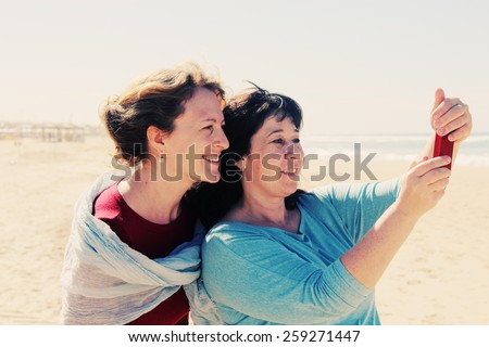 two best friends walking at seaside - stock photo