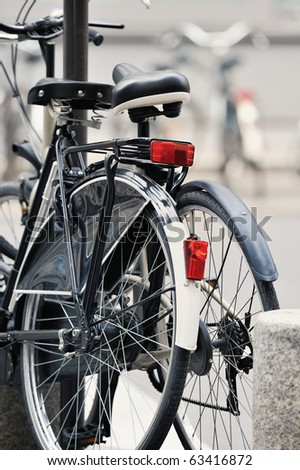 Two bicycle on the city street. Photo with tilt-shift lens - stock photo
