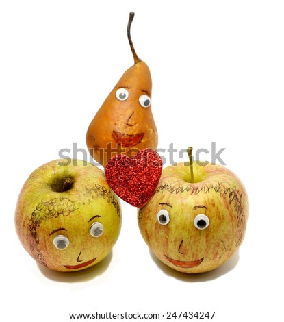 two big apples with a red heart and a PEAR with eyes - stock photo