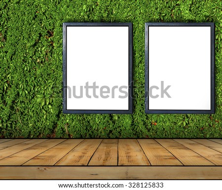 Two big blank billboard attached to a ivy wall with wooden floor - stock photo