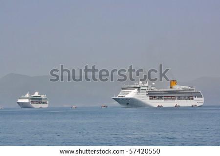 Two big cruise ships anchored in Corfu town bay, Corfu, Greece - stock photo