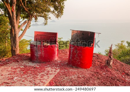 Two big red tanks for firecrackers on the top of island - stock photo