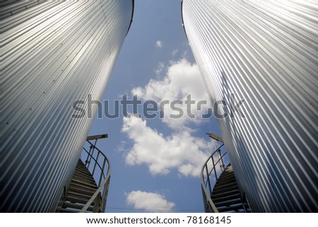 Two big reservoirs, with stairs and a blue sky - stock photo