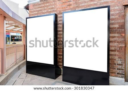 Two big vertical / portrait orientation blank billboard in park - stock photo