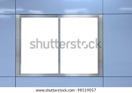 Two big vertical / portrait orientation blank billboard on modern blue wall - stock photo