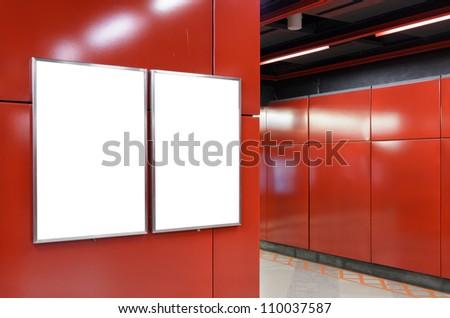 Two big vertical / portrait orientation blank billboard on modern red wall - stock photo